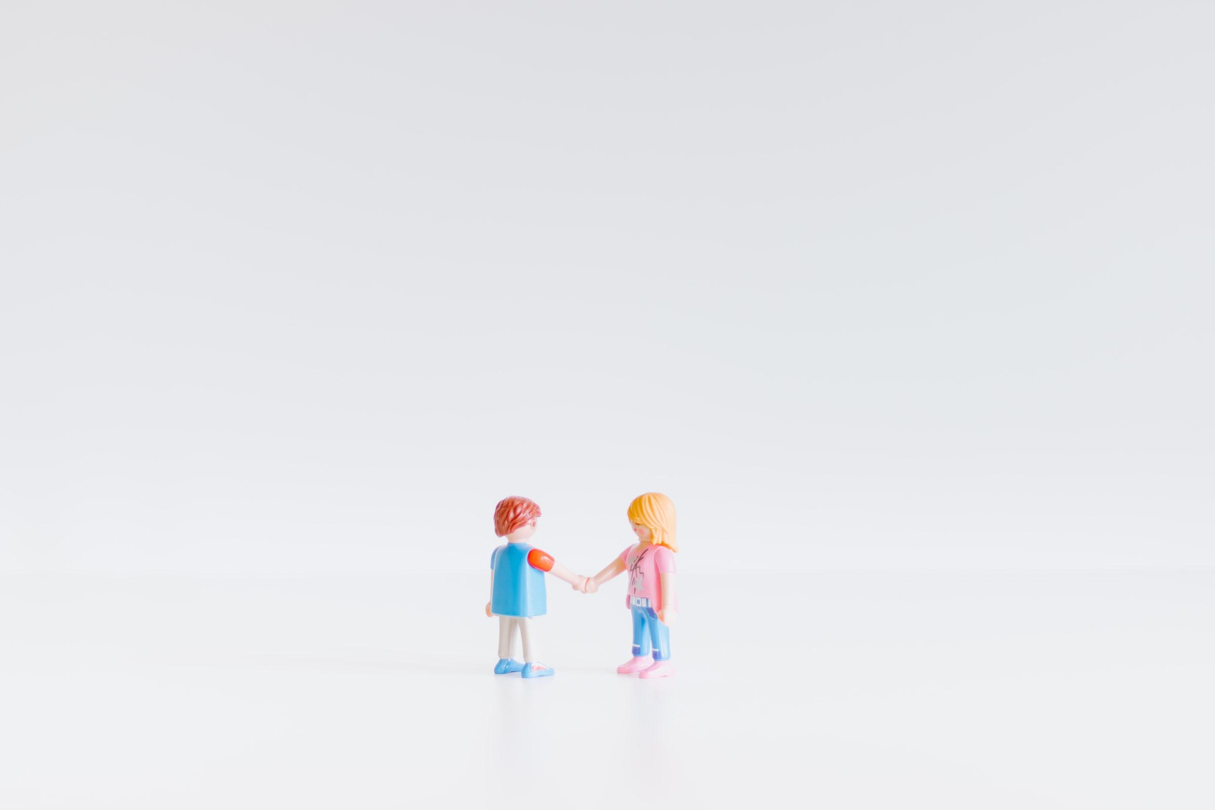 Figures shaking hands