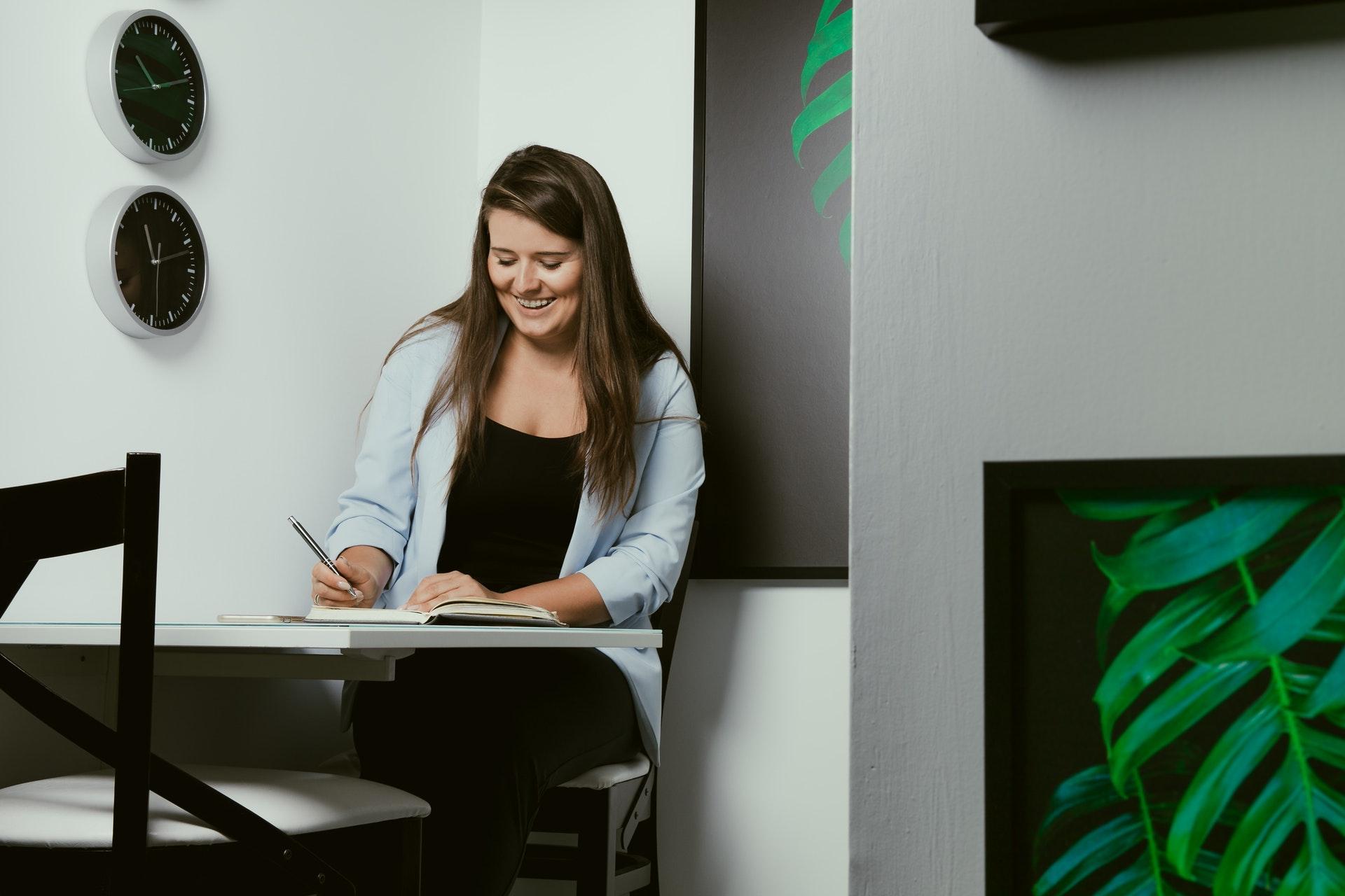 Woman writing in corner