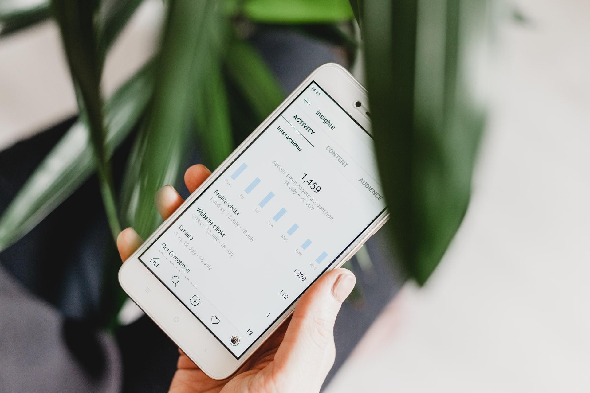 Phone showing Instagram analytics