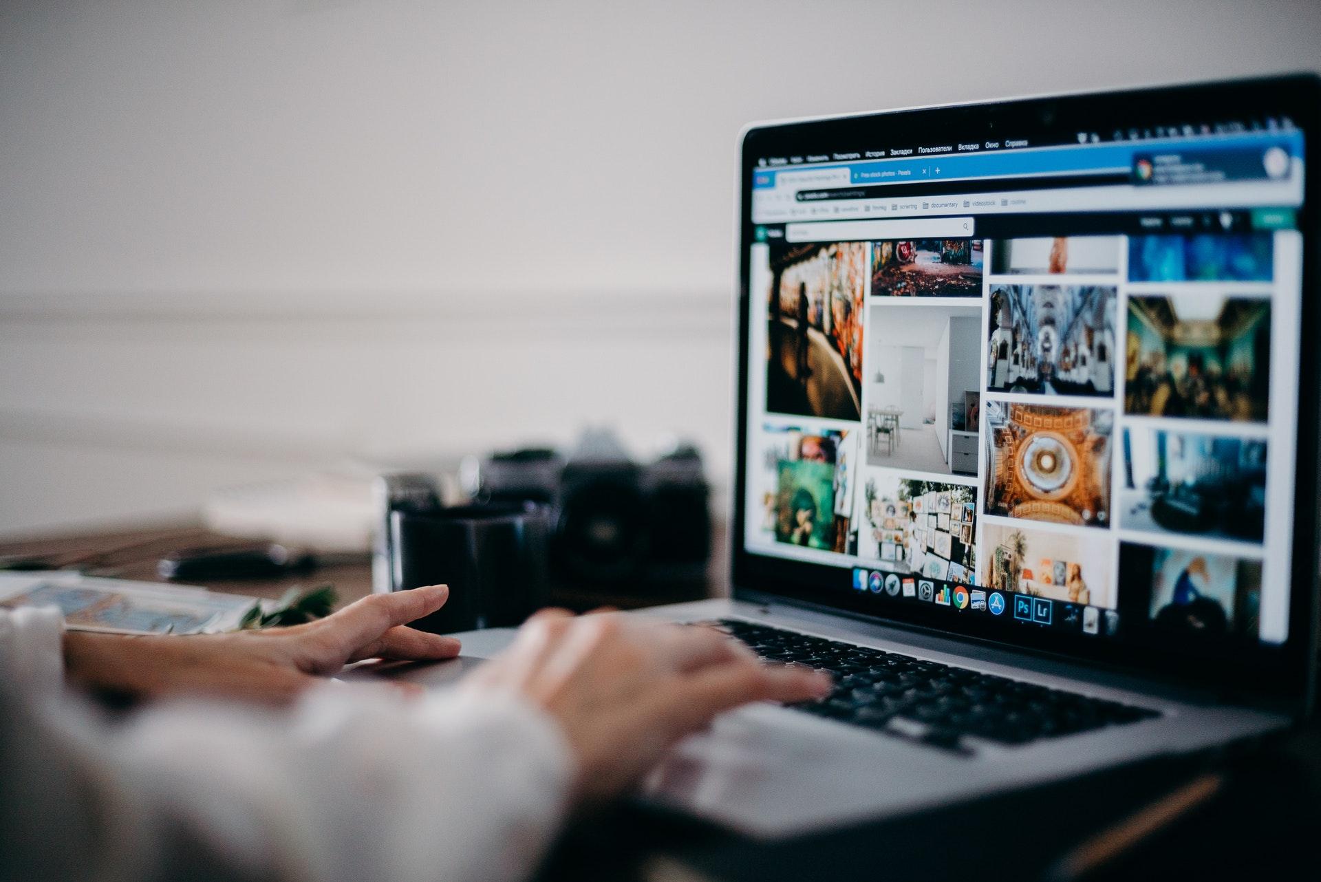 Person browsing Pexels website